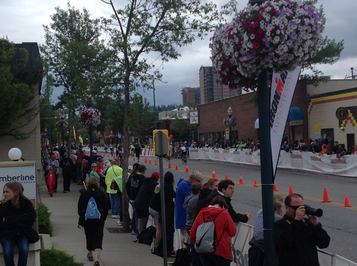 Supporters line the street to support Ironman CdA athletes during the bike portion of the race.